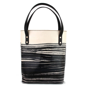 black veg tan leather tote bag