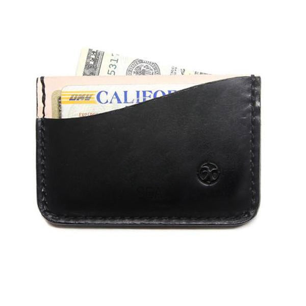 Black leather card holder with cards