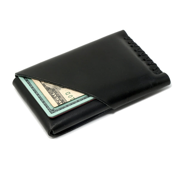 Minimal leather wallet black back angle with cards and cash