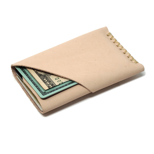 Minimalist natural veg tan leather front pocket card holder with cards and cash