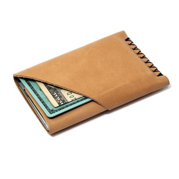 Minimalist brown leather front pocket card holder with cards and cash