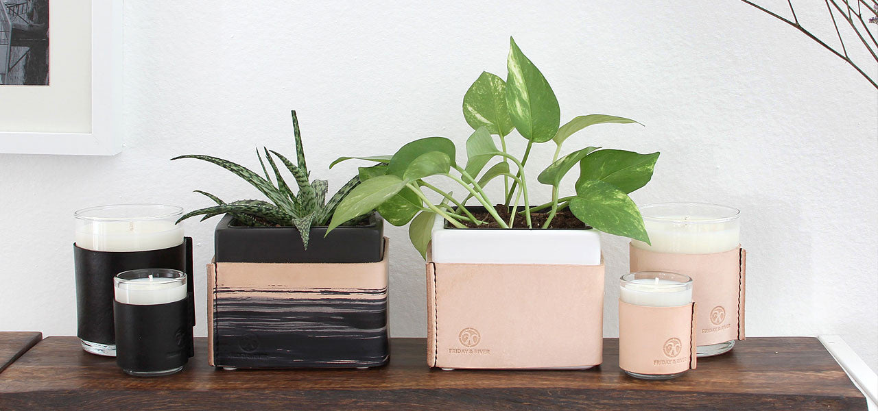 Leather wrapped candles planters coasters and valet tray