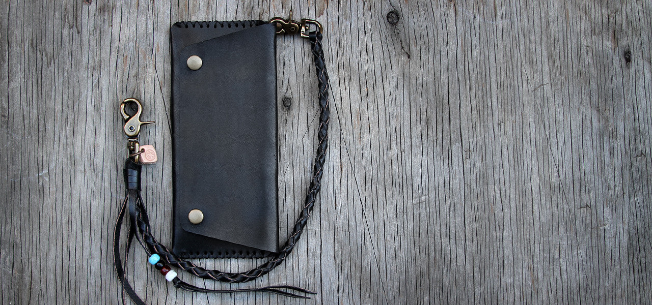 Black leather wallet with braided leather tether