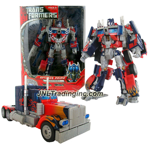 [Damage Box] Hasbro Year 2006 Series 1 Movie Leader Class 11 Inch Tall Electronic Robot Action Figure - OPTIMUS PRIME with Lights and Sounds Plus Flip Down Ion Blaster (Vehicle Mode: Rig Truck)