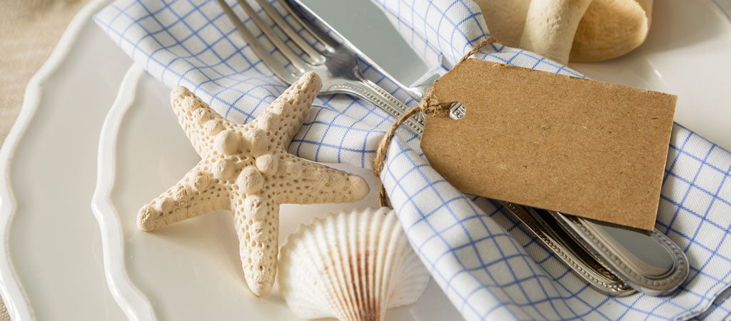 beach themed tablescape with seashells
