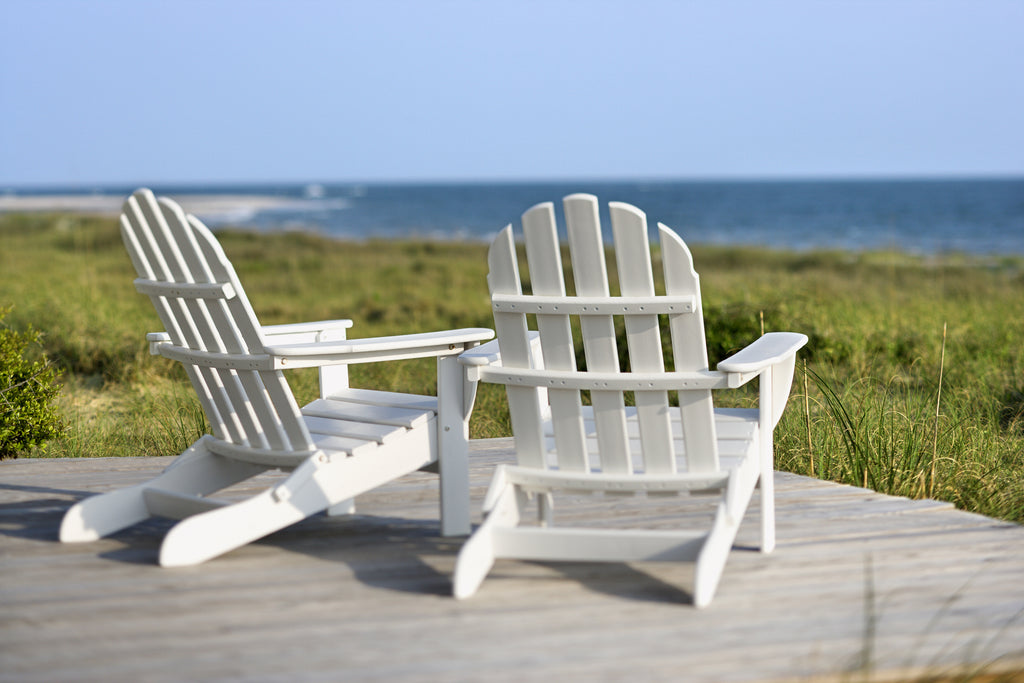 adirondack chairs facing the ocean