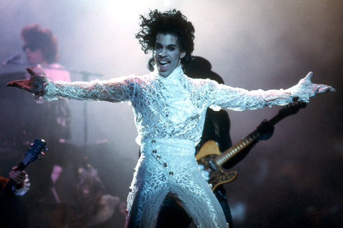 Prince sported a white lace two-piece outfit while letting loose in performance at California's Fabulous Forum on Feb. 19, 1985.