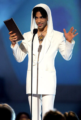 Sporting a mustache and a soul patch, a hooded Prince goes all-white at the People's Choice Awards at the Pasadena Civic Auditorium on January 9, 2005.