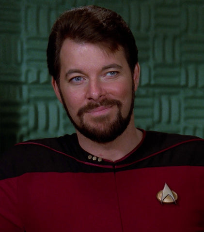 A bearded William Riker smiling