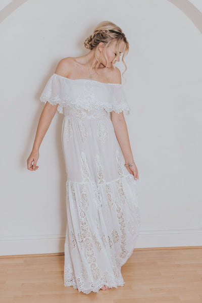 Aroha dress from the Practical Romantics Collection by Francis Bridal.  Off the shoulder wedding dress front view
