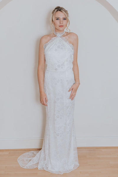 Halter neck wedding gown in silver ivory lace with small puddle train