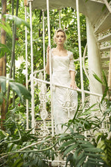 Quarantine Dress, a full length lace wedding dress with elbow length sleeves by Francis Bridal