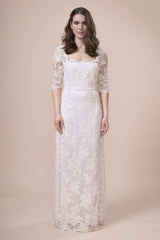 Quarante Dress, a full length lace wedding dress with elbow length sleeves by Francis Bridal