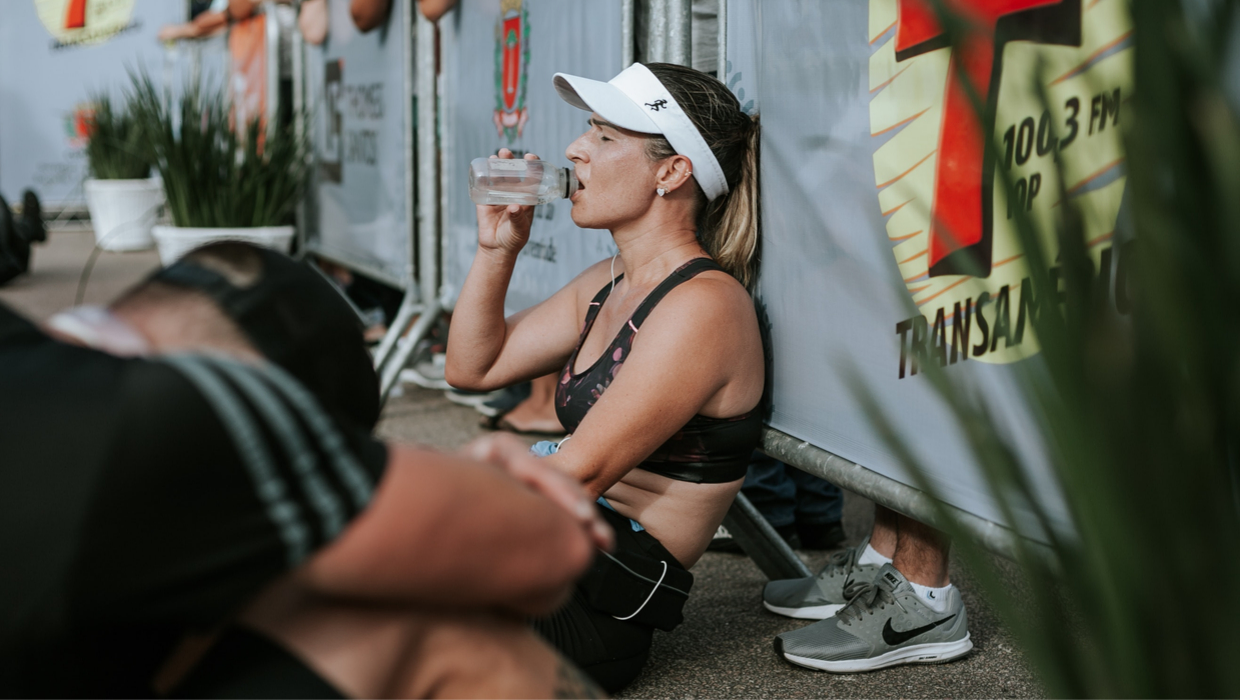 Woman hydrating after a workout