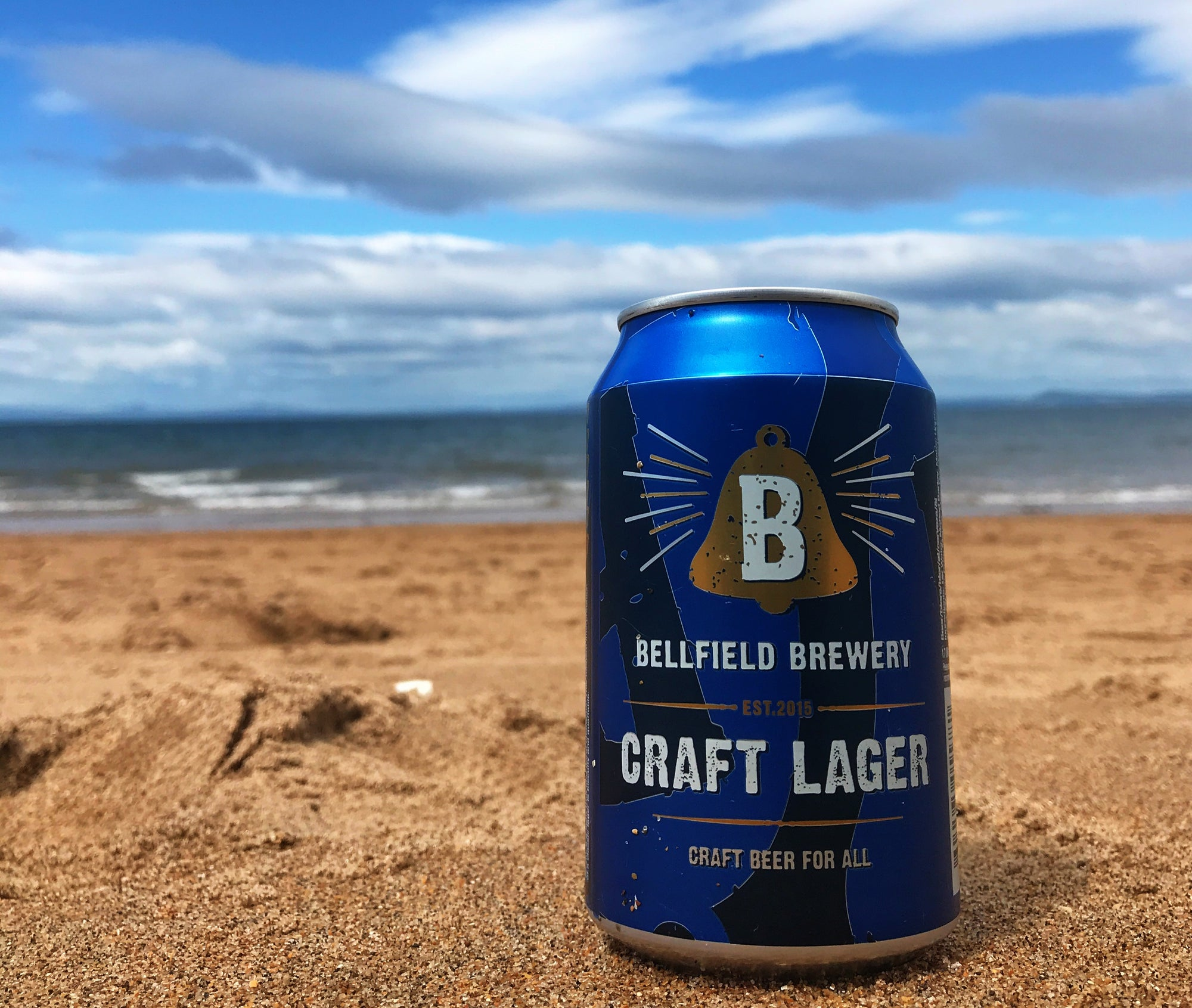 A can of craft lager pictured on a Scottish beach