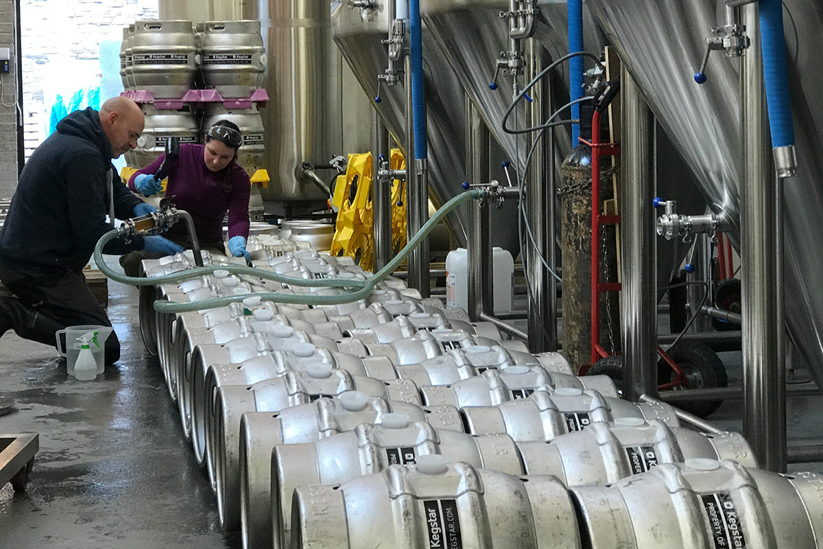 Kieran and Sally filling casks, pre-lockdown.