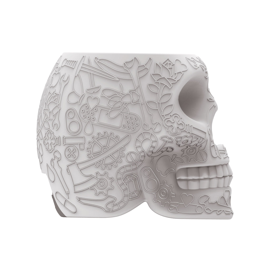https://cdn.shopify.com/s/files/1/1124/7646/products/Qeeboo-Mini-Mexico-Skull-Power-Bank-by-Studio-Job-Grey-Side_1024x1024.jpg?v=1535356754