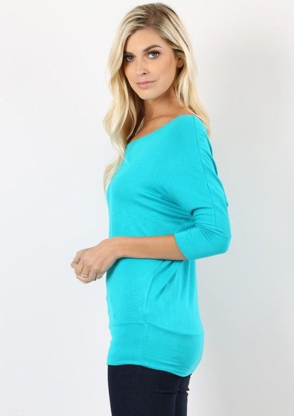 Retail Value $20  This light weight, solid dolman tunic is absolutely perfect with it's scoop neck,  3/4 sleeves and solid waist band.  This top is easily worn dressed up or down.   Color - Teal Fabric - 95% Rayon 5% Spandex Fix - True to size - loose fit