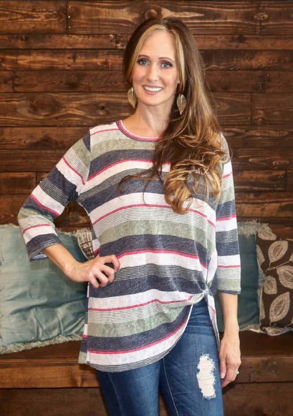This colorful striped top is adorable with its 3/4 sleeves and twisted hem on the front left side.  You can't go wrong it pairs well with nearly everything!  Color - Multi Colored Fabric - 78% Polyester 22% Rayon Fit - True to size