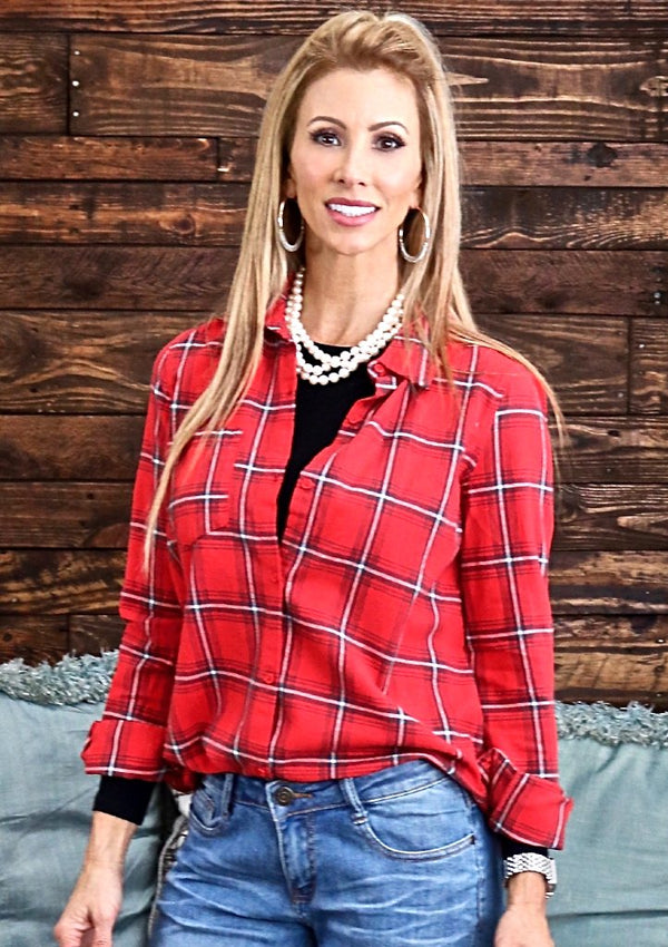 "I'm loving plaid this season and I'm seeing it everywhere!  This flannel plaid is amazing paired with boyfriend jeans and heels or skinny jeans and riding boots.  Color - Red, White and Grey Fabric - 100% Cotton Fit - True to size Nickie is 5'5"" wearing a small."