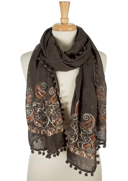"This super soft, lightweight scarf adds a touch of class to any outfit with its floral embroidery and pom pom trim.    Color - Charcoal Grey, Denim Blue, Burgundy Fabric - 65% Polyester 35% Viscose length - 26"" X 70"""