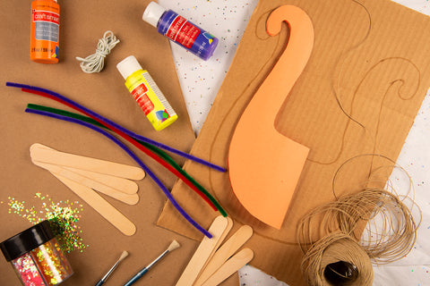 Overhead shot of Mato & Hash Sunday school cardboard and rubber band lyre craft materials