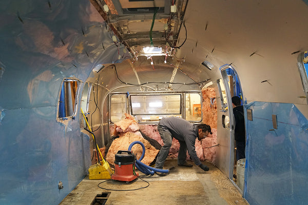 The inside of the airstream getting the insulation replaced with fresh stuff.