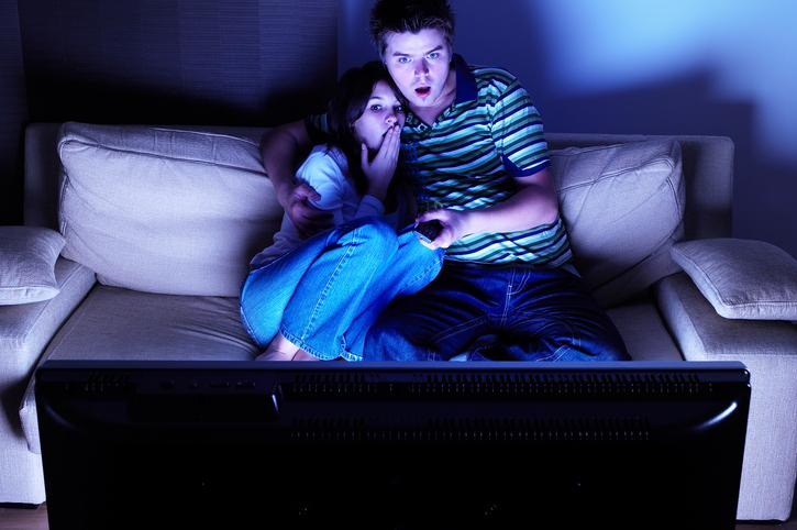 Couple on Couch Watching Horror Movie