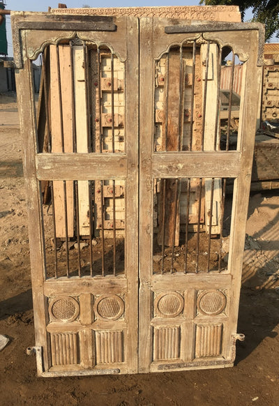 Wood Doors with Metal and Carved Accents