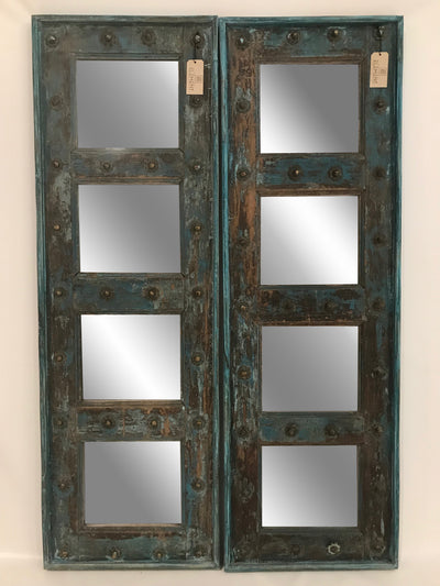 Blue Wooden Door with Four Mirrors