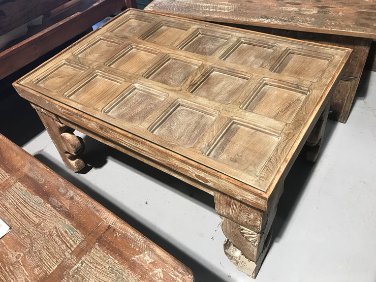 Wooden Coffee Table with Square Carvings and Glass on Top
