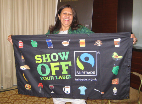 Padmini shows off the Fairtrade banner for Fairtrade Fortnight Dubai 2019 with Sabeena Ahmed