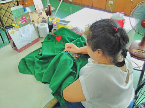 A lady embroidering a table cloth at the Good Shepherd Sisters Bangkok visited by Sabeena Ahmed june 2018