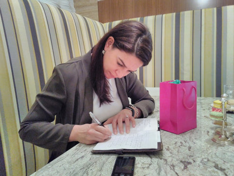 Ethical Dest Editor Anthea Ayache signing The Little Fair Trade Shop Guest Book - January 2017 Dubai UAE