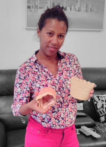 Marie Louise of Valy Exports Madagascar models small raffia purses visit Sabeena Ahmed of The Little Fair Trade Shop Dubai April 2019