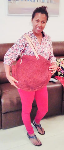 Marie Louise of Valy Exports Madagascar modelling a round red raffia bag visit Sabeena Ahmed of The Little Fair Trade Shop Dubai April 2019