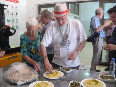 Fairtraders enjoying freshly prepared hummus in Fourzol - The Little Fair Trade Shop