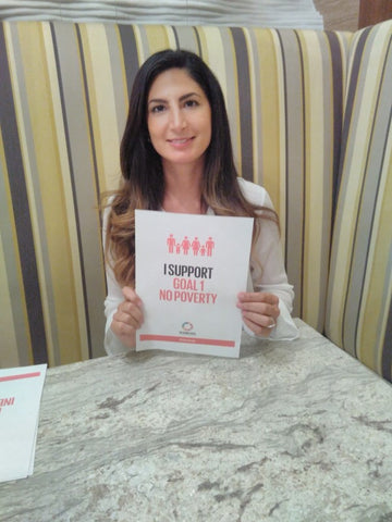 Anna Sadeghpour supporting global goal 1 No Poverty for Anti Poverty Week in the UAE with the Lilfairtrade Shop