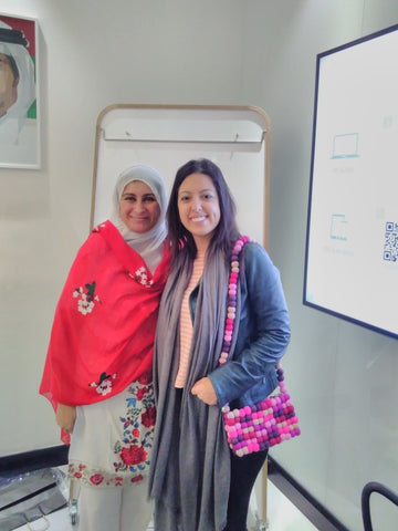 Sabeena Ahmed attending a workshop with Bel Pesce modelling a fairtrade breast cancer reearch bag, Dubai, December 2018