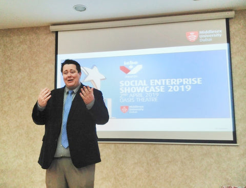 Dr Cody Paris introducing the teams at the Middlesex University Dubai  Social Enterprise Showcase April 19