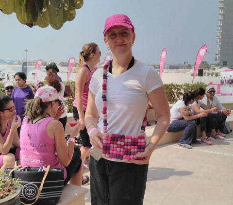 The inspirational Lisa organiser of the Pink Ladies Games and the Pink Caravan UAE modelling a totally bobbles pink fairtrade bag produced by fairtrade ladies at Friends Handicraft adn Maiti with the Lilfairtrade Shop