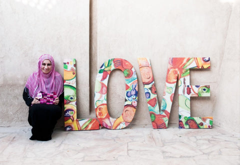 Sabeena Ahmed and The Little Fair Trade Shop modelling the gorgeous pink totally bobbles fair trade bag, Dubai, UAE, 2016