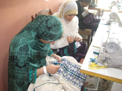 Ladies sewing at the WFTO SABAH PAKISTAN Head office Rawalpindi, Pakistan visited by Sabeena Ahmed