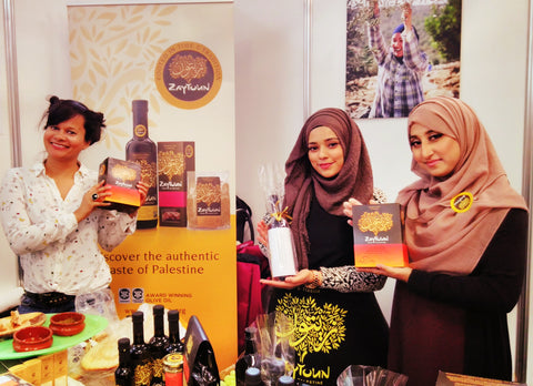 At the Zaytoun stand with volunteers at the Muslim Lifestyle Show London April 17