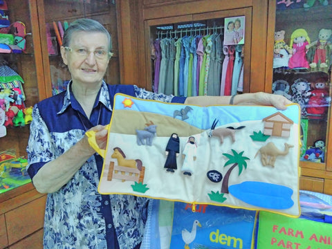 Sister Louise displaying In the desert childrens book Good Shepherd Sisters visited June 2018 by Sabeena Ahmed