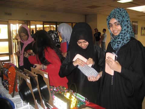 Students admiring fairtrade recycled gifts at the Preston University Ajman, visited May 2012 by Sabeena Ahmed The Little Fair Trade Shop