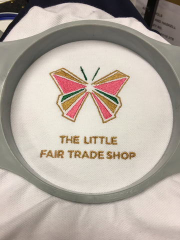 The beautiful fairrade butterfly brand logo for The Little Fair Trade Shop embroidered by Koolskools UK and designed by Helen Barlow Scott