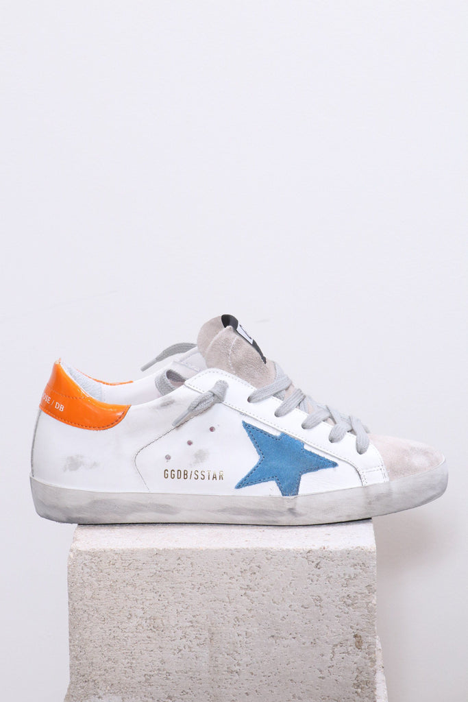 Golden Goose Superstar in White Leather w/ Light Blue Star - WE ARE ICONIC