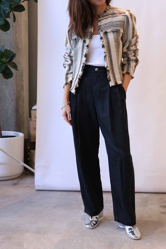 Raquel Allegra Pleated Pants in Black, Isabel Marant Etoile Jacket, MM6 Ankle Boots, Re/done Tank