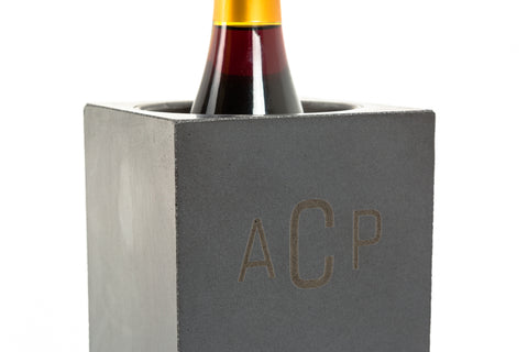 A personalized concrete wine cooler, shaped like a brick with a hollowed out center that allows for regulated temperature.